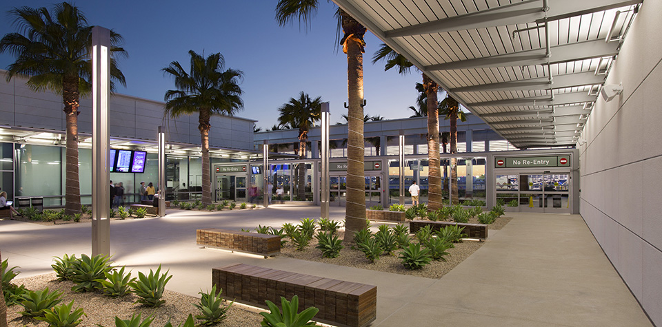 Modern Airport extension added to historic airtraffic control tower and check-in area
